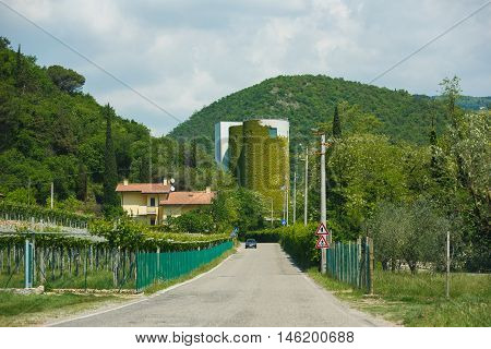 Molina Italy - May 07 2016: Industrial building overgrown with ivy on the way to the small resort town of Molina
