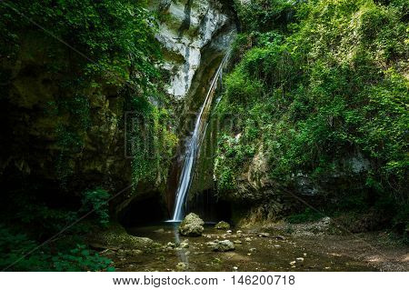 Waterfall in a forest of Molina Italy