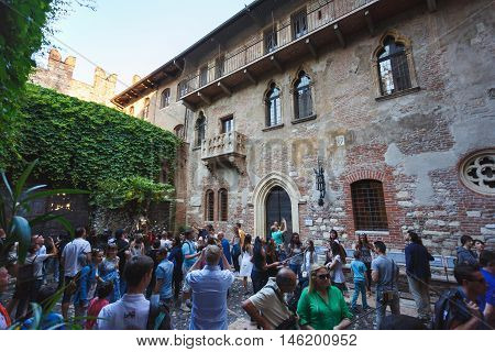 Verona Italy - May 07 2016: Many tourists visit to the courtyard of Juliet's house located in the tourist heart of the city