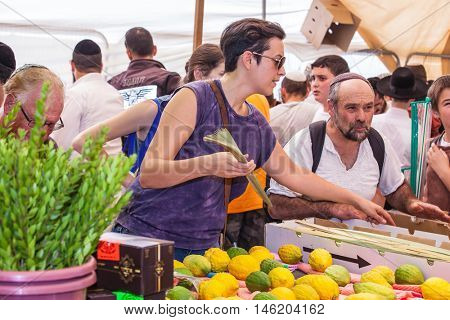 JERUSALEM, ISRAEL - OCTOBER 8, 2014: Religious Jews are buying products for the holiday. Sukkot in Israel. Traditional pre-market in Jerusalem