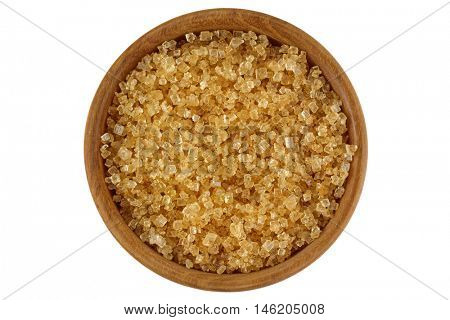 Top view of unrefined unbleached Crystalline sugar in crystal brown color in a wooden bowl isolated on white background