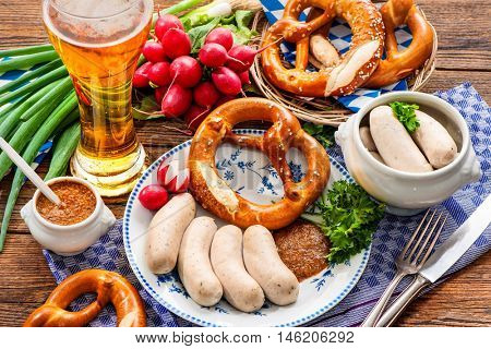 Traditional Bavarian meal. White sausages with sweet mustard and pretzel