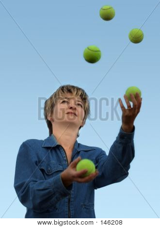 woman juggling with tennis balls poster