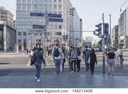 BERLIN GERMANY - SEPTEMBER 6 2016: Tourists At Traffic Lights At Potsdamer Platz Berlin Germany