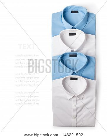 A row of white and blue male shirts isolated on white background closeup