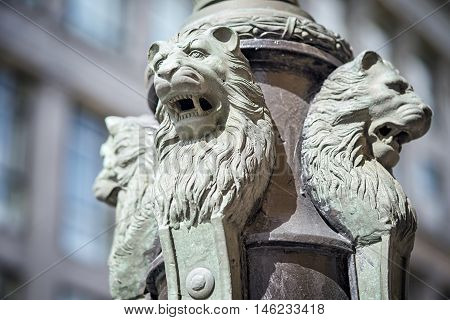 Sculpture of lions buttress fonanry pole on the Ilinka street in Moscow