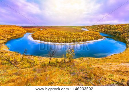 Autumn view of the Don river from the high hill at sunrise time. Russia.