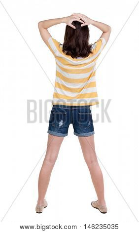 Back view of shocked woman in blue jeans shorts. girl hid his eyes behind his hands.  Rear view people collection.  backside view of person.  Isolated over white background.