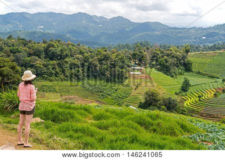 Back of the woman tourist at Mon Jam viewpoint at Chiang Mai Thailand.