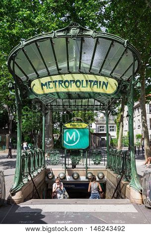 Paris France - July 06 2016: The entrance to the Abbesses subway station. It is a famous Art Nouveau symbol designed by Hector Guimard.