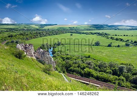 Summer landscape with river railway and cave temple in Divnogorsky Sacred Uspenskom a man's monastery. Voronezh region. Russia