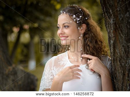 girl with beautifu smile in white dress
