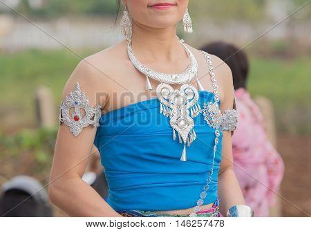 girl in blue thai dress in wax festival.