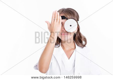 the woman doctor ENT with frontal reflector