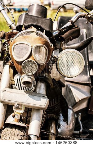 Detail of veteran motorbike with symbolic gas mask. Meeting bikers. Front view. Handlebars and headlight. Retro photo filter. Exhibitionism theme. poster