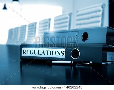Regulations - Folder on Black Office Desktop. File Folder with Inscription Regulations on Wooden Desktop. 3D.