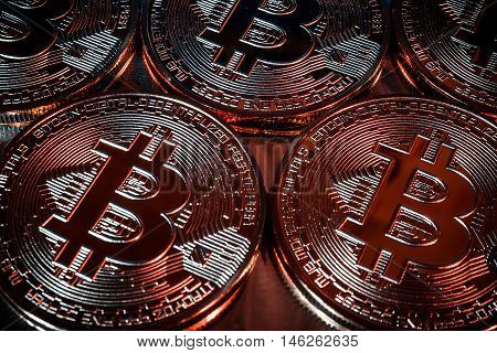 Photo Golden Bitcoins new virtual money Close-up on a black background.