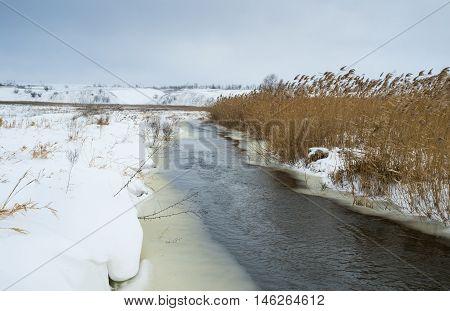 Winter landscape with small Ukrainian river Sura.