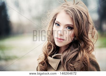 Young Woman Walking in the Park. Melancholy Girl Outdoors