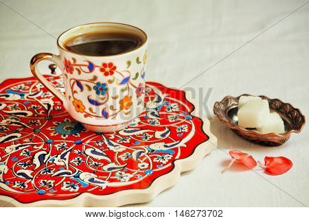 Selective focus on ceramic saucer and cup of coffee in Turkey