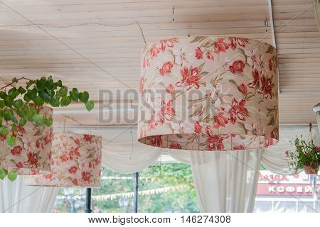 Fabric chandelier on street cafe or restaraunt.