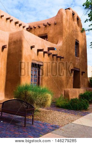 Southwestern adobe style building beside a garden taken in Santa Fe, NM