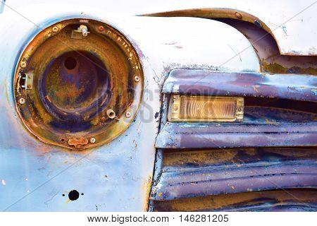 Classic car which has been torn apart taken in a junkyard
