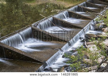 one of numerous diversion water diversion dams on the Poudre RIver in Fort Collins, Colorado