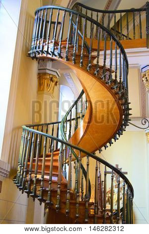 Santa Fe, NM - August 29, 2016:  Historic spiral staircase with 360 degree turns which is currently used for weddings and other events taken at the Loretto Chapel which is a former cathedral in Santa Fe, NM.