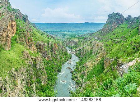 The scenic landscape of the Kura river gorge with the sharp rocks next to the Tmogvi Castle ruins Samtskhe-Javakheti Region Georgia.