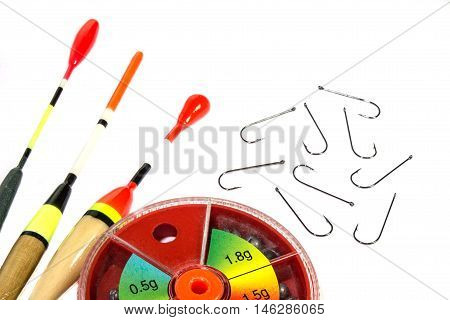 Fishing bobs with hooks and fishing sinkers on the white background
