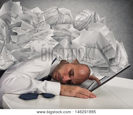 Businessman with a pile of sheets over his head