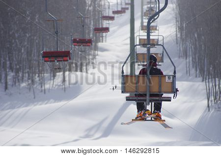 Man On An Old Chairlift
