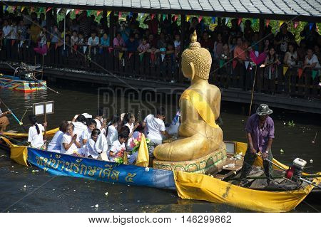 SAMUT PRAKAN , THAILAND - OCTOBER 26, 2015 : Beautiful flower boats in floating parade, the unique annual Rup Bua Festival ( Lotus Throwing Festival ) on end of Buddhist lent in Klong  Bangphli canal, Samut Prakan Province, Thailand.