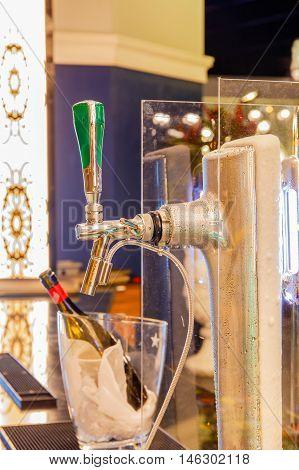 Close up beer dispenser valve in restaurant