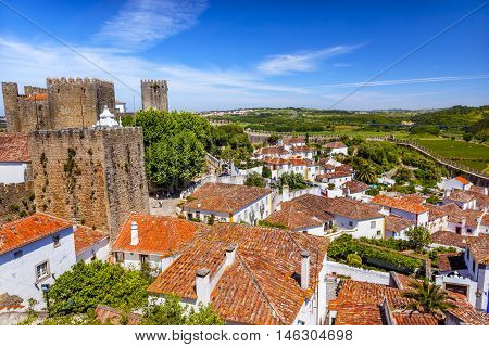 Castle Wals Turrets Towers Medieval Town Obidos Portugal. Castle and walls built in 11th century after town taken from the Moors.