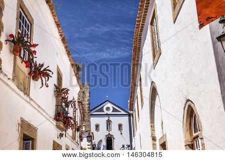 Sao Pedro Church Narrow White Street 11th Century Medieval Town Obidos Portugal. Built in the late 13th/early 14th century.