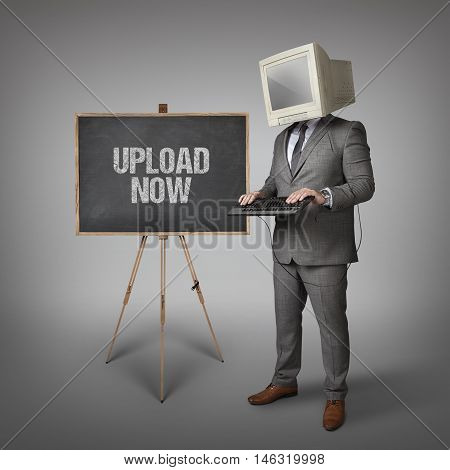 Upload now text on blackboard and computer monitor on businessman head