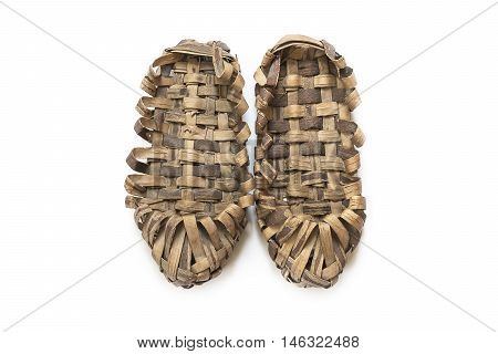 Pair of bast shoes on a wooden background