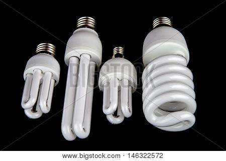 Selection of energy efficient lamps isolated against a black background