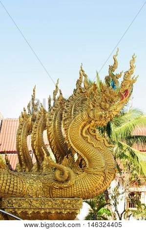 Naga statue in temple Thailand.Nan Nan-November 5 2015:Close up of decorated wall in front of Wat Si Pan Ton