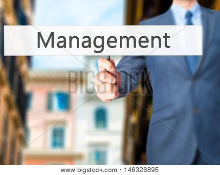 Management - Business Man Showing Sign