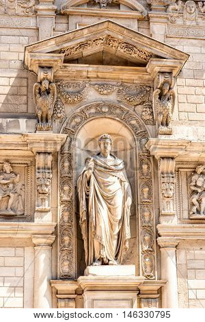 Statue on Giureconsulti palace in the center of Milan
