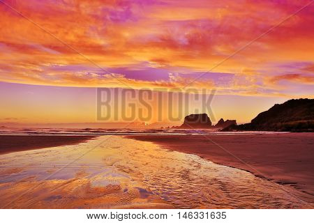 Sandy Beach At Sunset In Westport Of New Zealand.