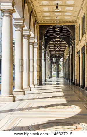 Street and columns in Milan, north of Italy