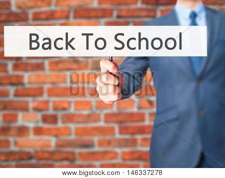Back To School - Business Man Showing Sign