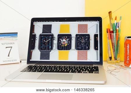 PARIS FRANCE - SEP 8 2016: Apple Computers website on MacBook Pro Retina in a geek creative room environment showcasing new Apple Watch Series 2 multiple clock faces