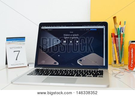PARIS FRANCE - SEP 8 2016: Apple Computers website on MacBook Pro Retina in a geek creative room environment showcasing the water resistant new Iphone 7
