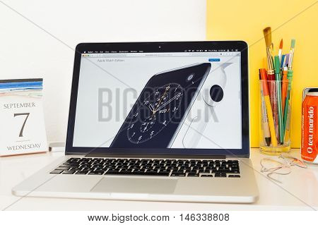 PARIS FRANCE - SEP 8 2016: Apple Computers website on MacBook Pro Retina in a geek creative room environment showcasing new Apple Watch Series 2 Edition made from Ceramic