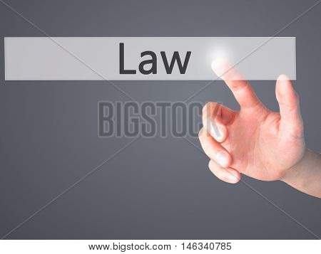 Law - Hand Pressing A Button On Blurred Background Concept On Visual Screen.